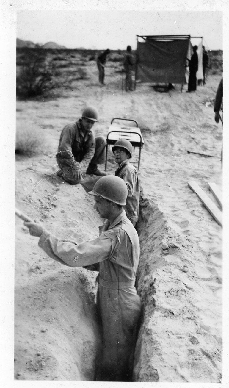 Clyde supervising digging a latrine