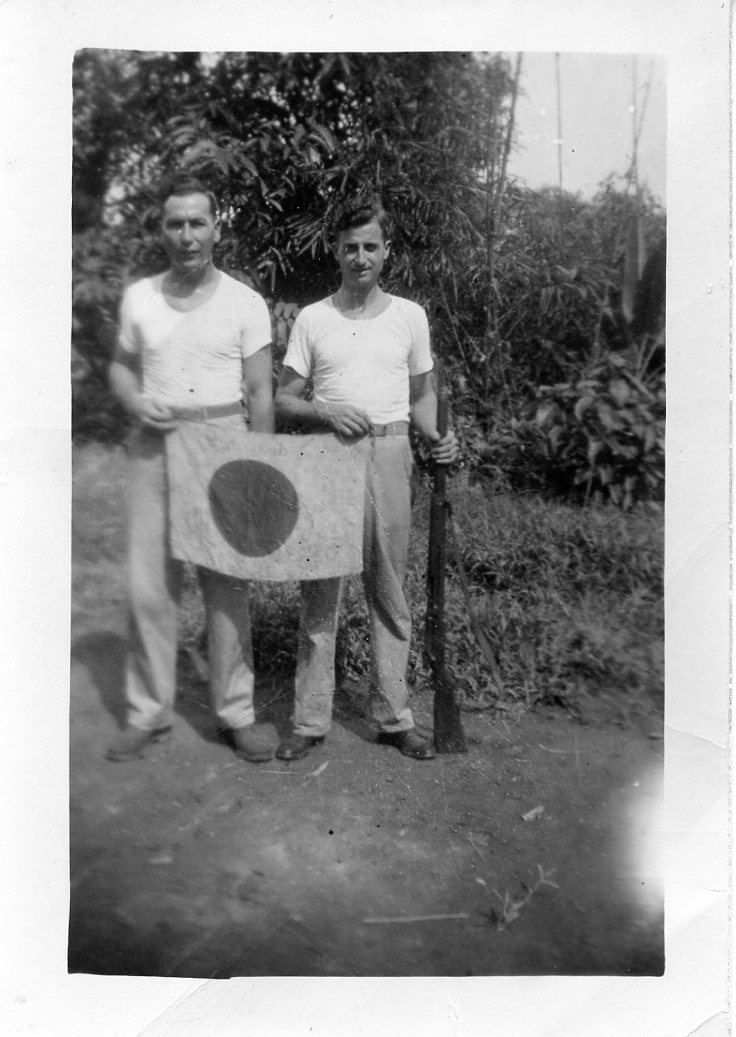Fred Bratton & Clyde with captured Japanese battle flag and Rifle (2)