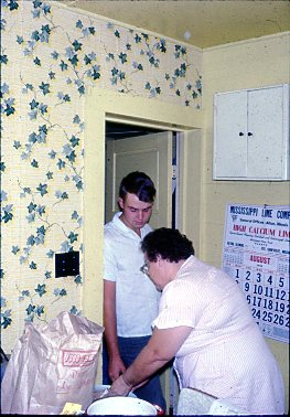 Bill & Mom in kitchen.1966
